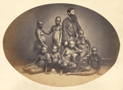 Andamanese group with Mr Homfray, their keeper, photographed at Calcutta.